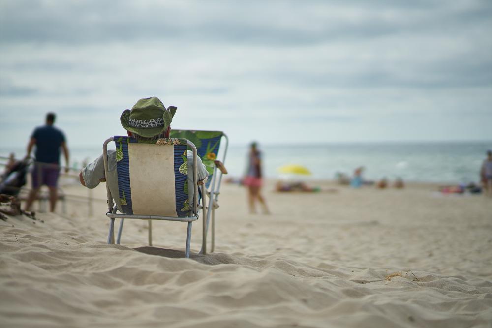 man relaxing on Panama City Beach